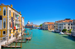 Famous Canal Grande in Venice, Italy. Canal Grande with Basilica Santa Maria della Salute with in the background as seen from Ponte dell'Accademia stock image