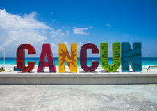 The famous Cancun sign. At Playa Delfines on a clear day with blue sky stock image