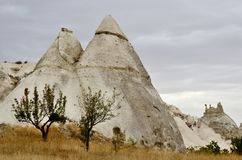 Famous Cappadocian landmark - volcanic rock formations with cave Royalty Free Stock Photo