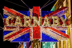 Famous Carnaby street in London, United Kingdom. Name of the famous London street Carnaby on the Union Jack flag at night Royalty Free Stock Image