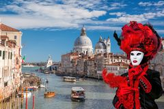 Famous Carnival mask on bridge against Grand Canal in Venice, Italy Royalty Free Stock Images
