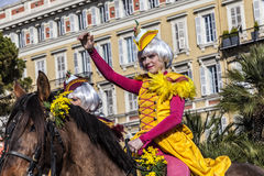 Famous Carnival of Nice, Flowers` battle. An english rider with the yellow costume greets the audience royalty free stock images