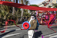 Famous Carnival of Nice, Flowers` battle.  Male Entertainer in carnival Costume launches colored ribbons Royalty Free Stock Image