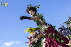 Famous Carnival of Nice, Flowers` battle. A woman entertainer launches mimosas Stock Images