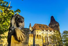 Famous castle in Budapest - Vajdahunyad with lion monument in fr Royalty Free Stock Images
