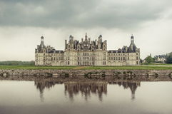 Famous castle in France. View of the famous castle in France by the pond Royalty Free Stock Photo