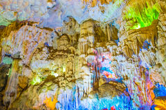 Famous cave in Halong bay illuminated by colorful lights Stock Image