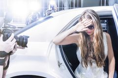 Actress stepping out of a limousine on a red carpet event Royalty Free Stock Photography