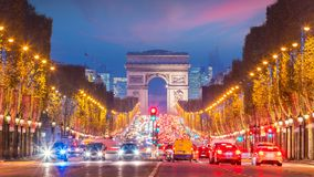 Famous Champs-Elysees and Arc de Triomphe at twilight in Paris. France royalty free stock images