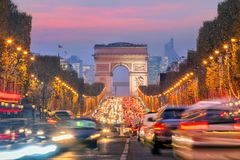 Famous Champs-Elysees and Arc de Triomphe at twilight in Paris. France royalty free stock photography