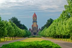 Famous chapel complex in South Cemetery in Leipzig, Germany. Famous chapel complex with beautiful alley in South Cemetery in Leipzig, Germany royalty free stock images