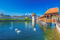Famous Chapel wooden bridge and water tower in Lucerne, Switzerland, Europe. Historic city center of Lucerne with famous Chapel Bridge, lake Lucerne ( Stock Photo