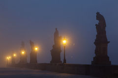 On the famous Charles Bridge in the morning mist, Prague, Czech Stock Images