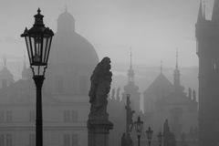 On the famous Charles Bridge in the morning mist, Prague, Czech Stock Photo