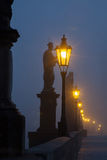 On the famous Charles Bridge in the morning mist Stock Photos