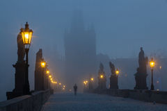 On the famous Charles Bridge in the morning mist Royalty Free Stock Photography