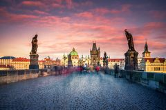 Famous Charles Bridge and tower, Prague, Czech Republic. Famous Charles Bridge and cityscape of Prague with medieval towers and colorful buildings, Czech royalty free stock photos