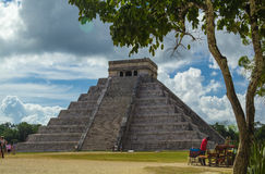 Famous Chichen Itza pyramid in Mexico. Ancient Mayan Kukulkan pyramid and a tree in Chichen Itza archaeological sight Stock Image