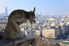 Famous chimera of Notre-Dame overlooking Paris. Stock Photo