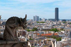 Famous Chimera overlooking the Montparnasse tower Royalty Free Stock Photos
