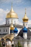 Famous christian place: Golden domes of Pochaiv Lavra on a clear day, Tenopil region. Ukraine royalty free stock images