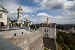 Famous christian place: Golden domes of Pochaiv Lavra on a clear day, Tenopil region. Pochaev, Ukraine - July 22 2009: Famous christian place: Golden domes of stock photography