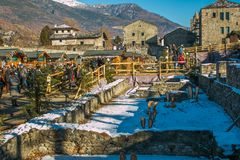 Famous Christmas Market In The Ancient Theatre Of Aosta With Snow In Winter Royalty Free Stock Photos