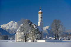 Landmark church in bavaria. Famous church St. Coloman nearby city fuessen in germany, bavaria, at winter in snow Stock Photography