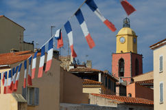 Famous church in St. Tropez with a row of French flags Stock Photo