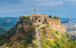 The famous Civita di Bagnoregio hit by the sun on a stormy day. Province of Viterbo, Lazio, Italy. stock image