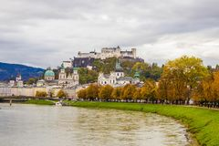 View of historic city of Salzburg over Salzach river,  with Festung Hohensalzburg. Famous classic view of historic old  city of Salzburg  with Festung Royalty Free Stock Images