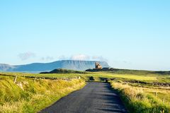 Famous Classiebawn Castle with Belbulbin mountain at the background in Sligo, Ireland. Sligo, Ireland. Famous Classiebawn Castle with Belbulbin mountain at the Stock Photography