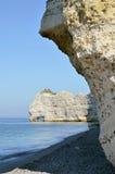 Famous cliffs of Etretat in France. Famous cliffs d'Amont of Etretat and arche Le Chaudron, commune in the Seine-Maritime department in the Haute-Normandie Stock Images
