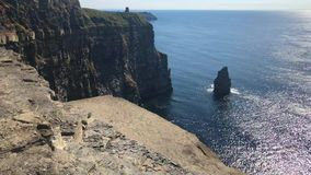 The famous Cliffs of Moher. Are sea cliffs located at the southwestern edge of the Burren region in County Clare, Ireland. They run for about 14 kilometres stock video footage
