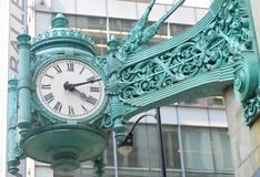 Famous clock in Chicago. Famous clock on the Marshall Field's building  in Chicago Stock Photo