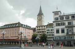 St Peter Church - Zurich. The famous clock and tower of the St Peter Church (Kirche) photographed from the Town Hall Bridge (Rathausbrucke&#x29 Stock Photography