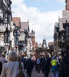 The Famous Clockin the Rows which are Tudor Black and White Buildings in Chester England stock images