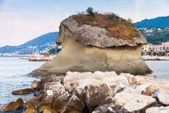 Famous coastal rock Il Fungo, Lacco Ameno. Famous coastal mushroom shaped rock Il Fungo. Lacco Ameno resort town, Ischia island, Italy Stock Image