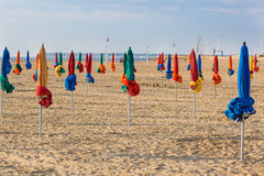The famous colorful parasols on Deauville Beach Stock Photo