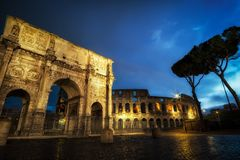 Colosseum and arch of constantine. Famous Colosseum and arch of constantine taken at night when the structures are still lit up Royalty Free Stock Photos