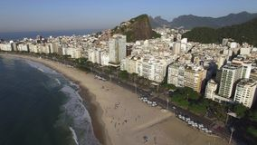 The famous Copacabana beach in Rio de Janeiro. Brazil South America. Christ the Redeemer mountain in the background stock video footage