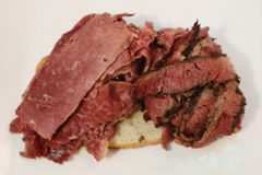 Famous Corned Beef and Pastrami on rye sandwich Royalty Free Stock Image