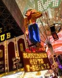 Famous Cowboy Neon Sign. Stock Photos