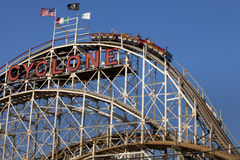 Famous Cyclone wooden roller coaster  Coney Island, Brooklyn, New York City. People riding the famous Cyclone wooden roller coaster onthe first or main drop in Stock Photo