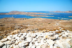 Famous   in delos greece the historycal acropolis and. In delos         greece the historycal acropolis and         old ruin site Stock Photo