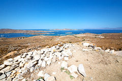 Famous   in delos  the historycal  old ruin site. In delos         greece the historycal acropolis and         old ruin site Royalty Free Stock Photography