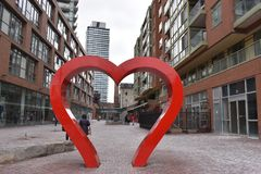 Famous Distillery District with a big heart sculpture and many red buildings in Toronto, Canada. Famous Distillery District with a big red heart sculpture and royalty free stock photo