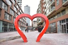 Famous Distillery District with a big heart sculpture and many red buildings in Toronto, Canada royalty free stock photography