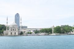 Famous Dolmabahce Mosque in Istanbul as seen from a Bosphorus Ferry, in Turkey. Dolmabahce Mosque and Palace in Istanbul, as seen from a Bosphorus Ferry, in stock photos