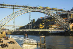 Famous Dom Luis I Bridge at Ribeira in Porto, Douro river and Old Town. Royalty Free Stock Image